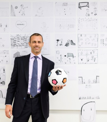 NYON, SWITZERLAND - APRIL 08:  **EMBARGOED UNTIL August 31, 2019** UEFA President Aleksander Ceferin makes a final selection of children drawings at the UEFA Foundation for Children for the UEFA Super Cup 2020 match ball in the UEFA headquarters, the House of European Football on April 8, 2019 in Nyon, Switzerland. More than 200 drawings from children were received following a competition among 12 UEFA Foundation for Children projects. The UEFA Super Cup 2020 match ball will feature a collage based on 20 selected sketches. (Photo by Harold Cunningham - UEFA/UEFA via Getty Images)