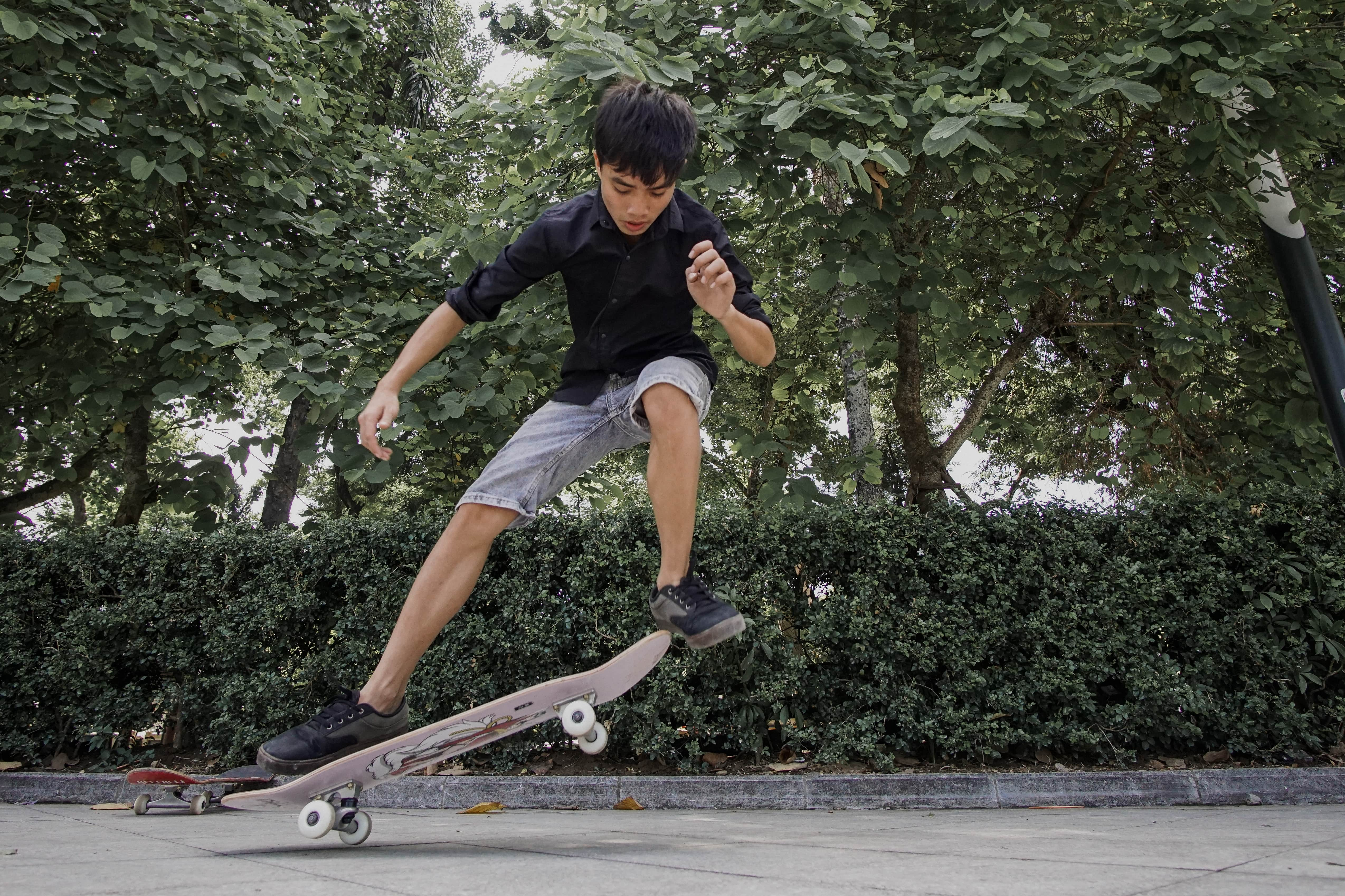Blue Dragon-A child practicing skateboarding