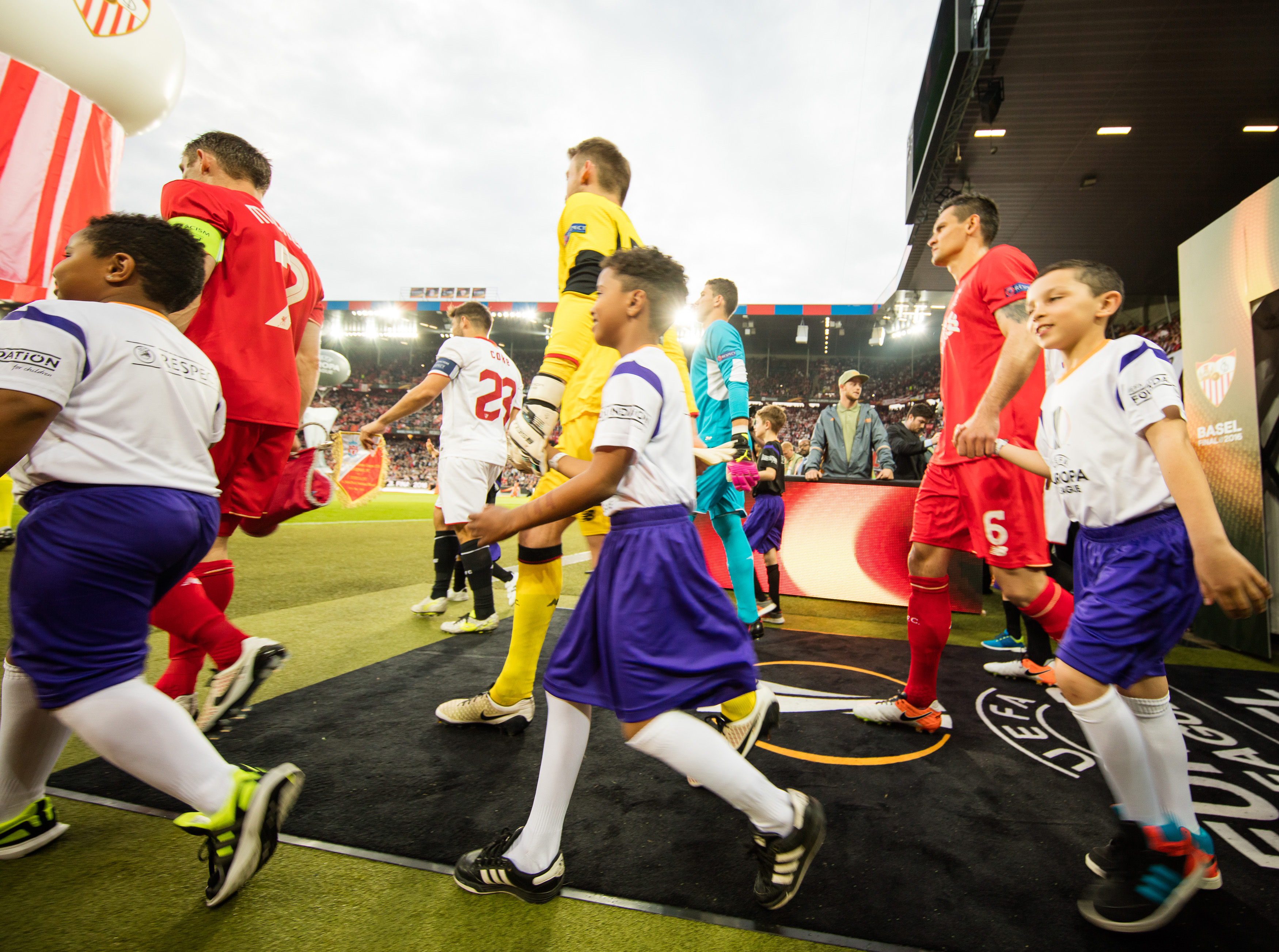 BASEL, SWITZERLAND - MAY 18:  Fedex player escort kids are seen prior to the UEFA Europa League Final between Liverpool and Sevilla at St. Jakob-Park on May 18, 2016 in Basel, Switzerland.  (Photo by Simon Hofmann - UEFA/UEFA via Getty Images)