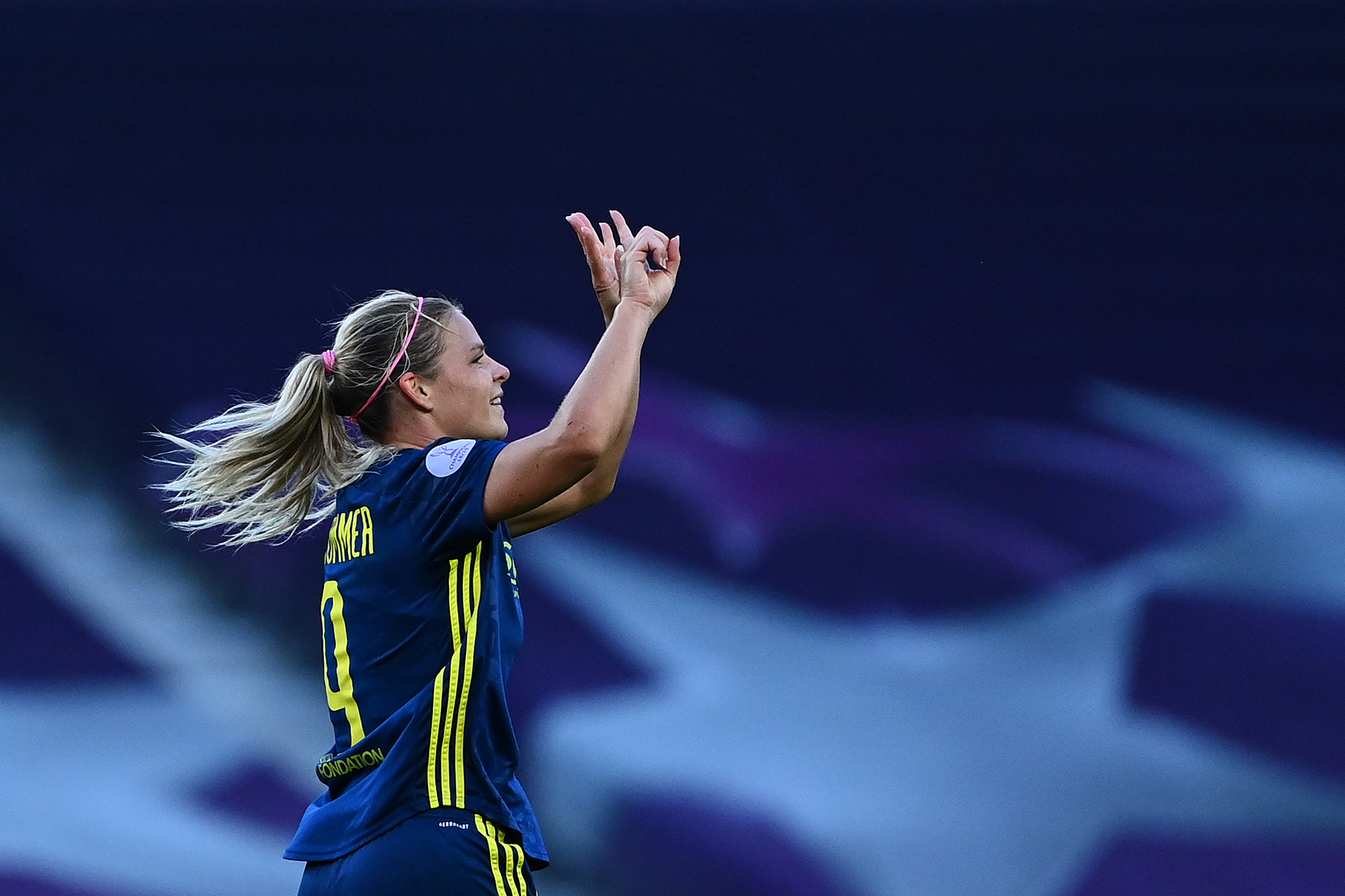 Lyon's French forward Eugenie Le Sommer celebrates after scoring the opening goal during the UEFA Women's Champions League final football match between VfL Wolfsburg and Lyon at the Anoeta stadium in San Sebastian on August 30, 2020. (Photo by GABRIEL BOUYS / POOL / AFP) (Photo by GABRIEL BOUYS/POOL/AFP via Getty Images)